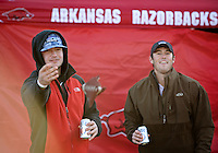 NWA Democrat-Gazette/BEN GOFF @NWABENGOFF<br /> Kory Pollard (left) and Easton Stallings, both of Fort Smith,  play a round of cornhole on Saturday Nov. 21, 2015 while tailgating before the Arkansas football game against Mississippi State in Fayetteville.