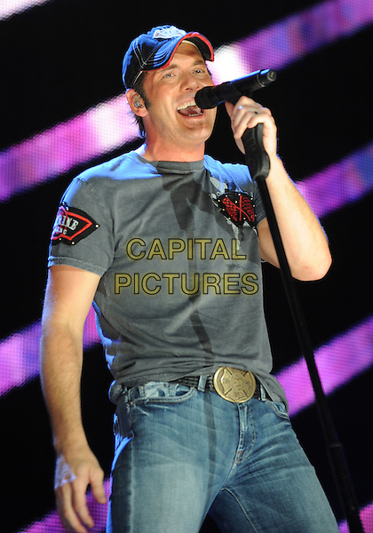 RODNEY ADKINS .2008 CMA Music Festival Nightly Concert held on Vault Concert Stage at LP Field, Nashville, Tennessee, USA..June 7th, 2008.stage concert live gig performance music half length black grey gray t-shirt baseball cap hat microphone singing .CAP/ADM/LF.©Laura Farr/AdMedia/Capital Pictures.
