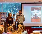 "July 26, 2017. Raleigh, North Carolina.<br /> <br /> Rachael Borowy and Ryan Smith of the US Committee for Refugees and Immigrants spoke to the crowd before Alan Gratz's author's talk. <br /> <br /> Author Alan Gratz spoke about and signed his new book ""Refugee"" at Quail Ridge Books. The young adult fiction novel contrasts the stories of three refugees from different time periods, a Jewish boy in 1930's Germany , a Cuban girl in 1994 and a Syrian boy in 2015."