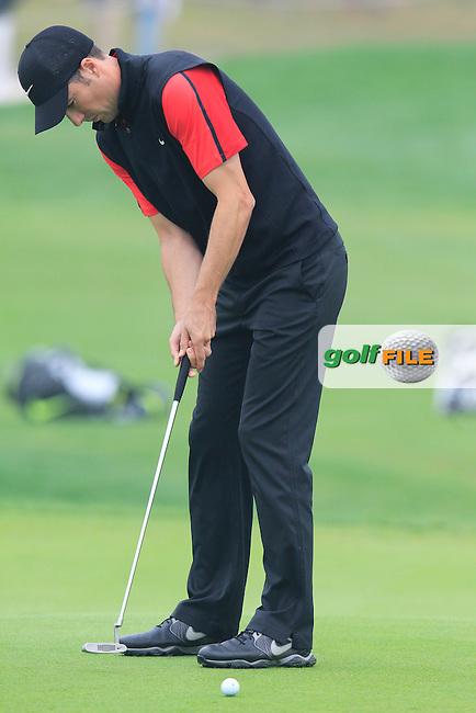 Ross Fisher (ENG) putts on the 17th green during Saturay's Round 3 of the 2014 BMW Masters held at Lake Malaren, Shanghai, China. 1st November 2014.<br /> Picture: Eoin Clarke www.golffile.ie