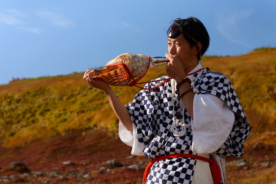 Yamabushi Masanori Naruse blowing a conch shell, Mt Gassan, Dewa Sanzan, Tsuruoka-city, Yamagata Prefecture, Japan, October 17, 2012.