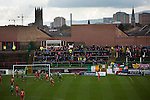 Glentoran 2 Cliftonville 1, 22/10/2016. The Oval, NIFL Premiership. Away supporters watching the first-half action at The Oval, Belfast as Glentoran (in green) host city-rivals Cliftonville in an NIFL Premiership match. Glentoran, formed in 1892, have been based at The Oval since their formation and are historically one of Northern Ireland's 'big two' football clubs. They had an unprecendentally bad start to the 2016-17 league campaign, but came from behind to win this fixture 2-1, watched by a crowd of 1872. Photo by Colin McPherson.