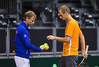September 09, 2014,Netherlands, Amsterdam, Ziggo Dome, Davis Cup Netherlands-Croatia, Training Dutch Team, Thiemo de Baker gets balls from captain Jan Siemerink<br /> Photo: Tennisimages/Henk Koster