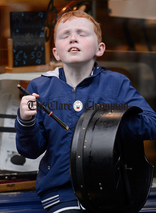 Adam Martin of Kilcolgan playing in the street at Fleadh Cheoil na hEireann in Ennis. Photograph by John Kelly.