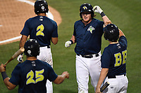 First baseman Dash Winningham (34) of the Columbia Fireflies is congratulated after scoring a run in a game against the Lexington Legends on Thursday, June 8, 2017, at Spirit Communications Park in Columbia, South Carolina. Columbia won, 8-0. (Tom Priddy/Four Seam Images)