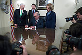 Director of National Intelligence Dan Coats (2-R), with his wife Marsha Coats (R), family members and United States Vice President Mike Pence (L), signs an affidavit  during a swearing in ceremony in the US Capitol in Washington, DC, USA, 16 March 2017.<br /> Credit: Shawn Thew / Pool via CNP