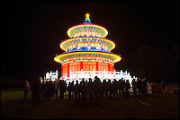 BNPS.co.uk (01202 558833)<br /> Pic: PhilYeomans/BNPS<br /> <br /> Beijings Temple of Heaven is recreated in fabric and light on the front lawn.<br /> <br /> The largest Chinese 'Festival of Light' seen in Europe is taking shape at the Longleat House in Wiltshire - A small army of over 50 skillled workers have flown in from the remote village of Zigong in central China to create the stunning spectacle.<br /> <br /> Among the different scenes are a 20-metre tall Chinese temple, a 70-metre-long dragon, created using more than 10,000 porcelain cups, bowls, plates and dishes, and the mythical qilin &ndash; a chimerical hooved creature with the head of a lion &ndash; featuring more than 30,000 glass phials filled with coloured liquid.<br /> <br /> Massive traditional Chinese masks are also featured and there is also a bamboo forest which is home to a family of life-size pandas, giant elephants, zebras, lions and deer as well as giant lotus flowers floating on the lake.<br /> <br /> Filled with thousands of LED lights and handmade by a team of 50 highly-skilled craftsmen from Zigong in China's Sichuan province, the lanterns recreate a magical world of myths and legends.<br /> <br /> Set amid the beautiful backdrop of the landscaped grounds and gardens surrounding Longleat House, the lit structures also spill out on to Half Mile Lake to create a stunning and enchanting experience for visitors.<br /> <br /> It&rsquo;s the first time a festival of this size has taken place in the UK and the Chinese team behind the spectacular event believe its size and complexity make it unique throughout Europe.