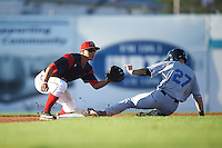Batavia Muckdogs second baseman Mike Garzillo (11) waits for a throw as Jake Fraley (27) slides in during a game against the Hudson Valley Renegades on August 1, 2016 at Dwyer Stadium in Batavia, New York.  Hudson Valley defeated Batavia 5-1. (Mike Janes/Four Seam Images)