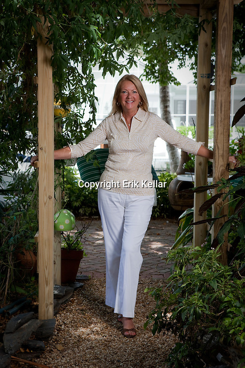 Joanne Lawand of Lawand Interiors in her garden. Erik Kellar/Special to the Naples Daily News.