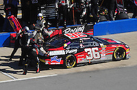 Nov. 1, 2009; Talladega, AL, USA; NASCAR Sprint Cup Series driver Robert Richardson Jr pits during the Amp Energy 500 at the Talladega Superspeedway. Mandatory Credit: Mark J. Rebilas-