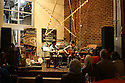 "Fullsteam Brewery, downtown Durham. David Garner (left), visiting lecturer in music at Duke, and Jay Hammond, a graduate student in cultural anthropology, play a few early jazz standards at ""Beer and Banjos,"" a library-sponsored event about the historical roots and cultural significance of the banjo. The event also featured a short talk by Laurent Dubois, Duke professor of romance studies and history, who is writing a book about the banjo's history. Photo by Aaron Welborn, director of communications, Duke University […]"