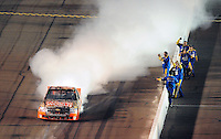 Nov. 7, 2008; Avondale, AZ, USA; Nascar Craftsman Truck Series driver Kevin Harvick celebrates alongside his crew after winning the Lucas Oil 150 at Phoenix International Raceway. Mandatory Credit: Mark J. Rebilas-
