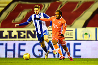 Wigan Athletic's Cheyenne Dunkley competes with Blackpool's Nathan Delfouneso<br /> <br /> Photographer Richard Martin-Roberts/CameraSport<br /> <br /> The EFL Sky Bet League One - Wigan Athletic v Blackpool - Tuesday 13th February 2018 - DW Stadium - Wigan<br /> <br /> World Copyright &not;&copy; 2018 CameraSport. All rights reserved. 43 Linden Ave. Countesthorpe. Leicester. England. LE8 5PG - Tel: +44 (0) 116 277 4147 - admin@camerasport.com - www.camerasport.com