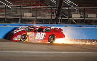 Apr 16, 2009; Avondale, AZ, USA; NASCAR Camping World Series West driver David Gilliland crashes into the wall while leading during the Jimmie Johnson Foundation 150 at Phoenix International Raceway. Mandatory Credit: Mark J. Rebilas-