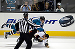 San Jose Sharks left wing Brad Winchester (10) jumps on top of Anaheim Ducks left wing Mark Bell (18) during a fight in the third period of an NHL preseason hockey game in San Jose, Calif., Friday, Sept. 23, 2011. The Sharks defeated the Ducks 5-1. (AP Photo/Paul Sakuma)