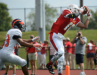 RRXSPRINT20P<br /> Chestnut Hill College's Josean Perez #11 catches the schools first touchdown ever as Princeton's Josh Payen #33 chases during their first sprint football game at Plymouth Whitmarsh High School Saturday September 19, 2015 in Plymouth Meeting, Pennsylvania. Sprint football is mush like the regular version, except the players can not weigh more then 172 pounds. (William Thomas Cain/For The Inquirer)