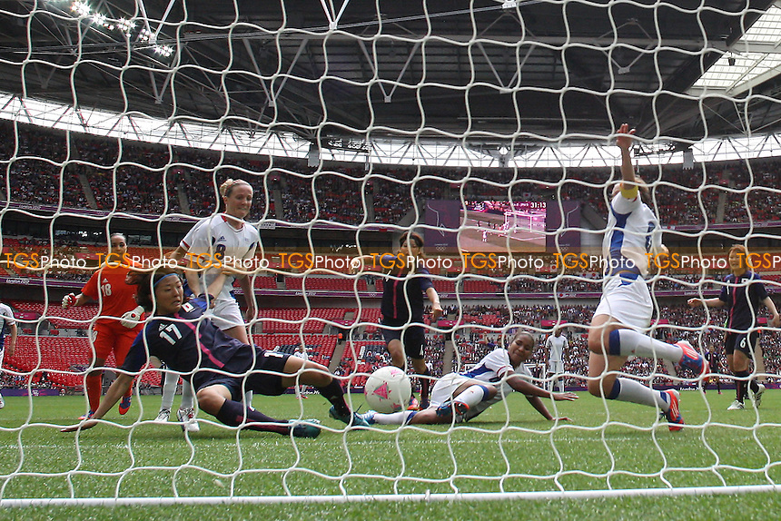 Yuki OGIMI of Japan scores the first goal for Japan - France Women vs Japan Women - Womens Olympic Football Tournament London 2012 Semi-Final at Wembley Stadium - 06/08/12 - MANDATORY CREDIT: Gavin Ellis/SHEKICKS/TGSPHOTO - Self billing applies where appropriate - 0845 094 6026 - contact@tgsphoto.co.uk - NO UNPAID USE.