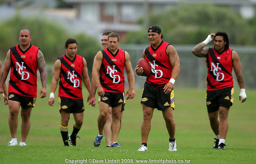 Chris Masoe leads the Hurricanes red team onto the field during the Preseason Cross-code Rugby Union v Australian Rules friendly between the Hurricanes and Wellington Tigers at  Elsdon Park, Porirua, New Zealand on Tuesday, 15 January 2008. Photo: Dave Lintott / lintottphoto.co.nz