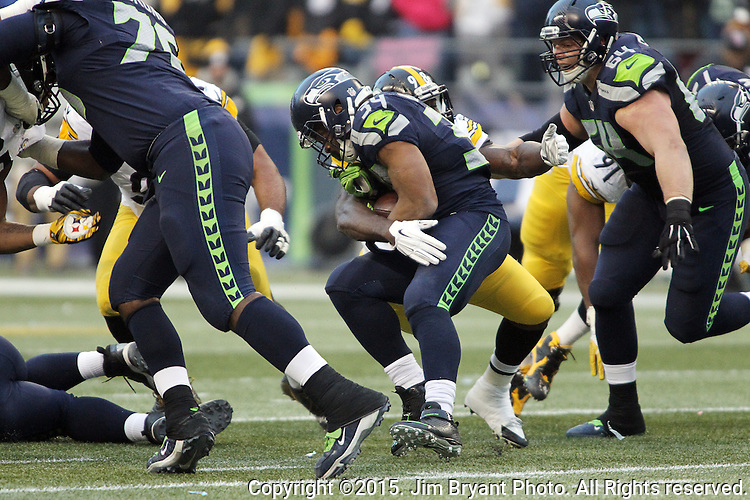 Seattle Seahawks running back Thomas Rawls (34) is wrapped up by Pittsburgh Steeler linebacker Vince Williams (98)  at CenturyLink Field in Seattle, Washington on November 29, 2015.  The Seahawks beat the Steelers 39-30.      ©2015. Jim Bryant Photo. All Rights Reserved.