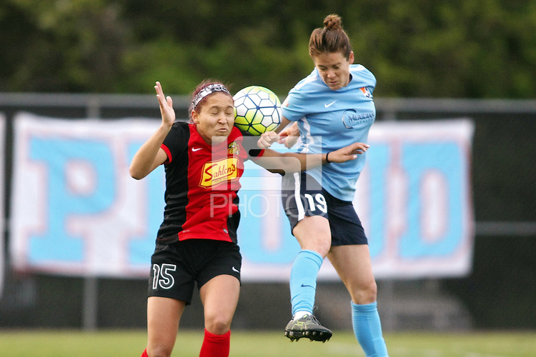 Piscataway, NJ, May 7, 2016. Defender Kelley O'Hara (19) of Sky Blue FC battles defender Jaelene Hinkle (15) of the Western New York Flash.  The Western New York Flash defeated Sky Blue FC, 2-1, in a National Women's Soccer League (NWSL) match at Yurcak Field.