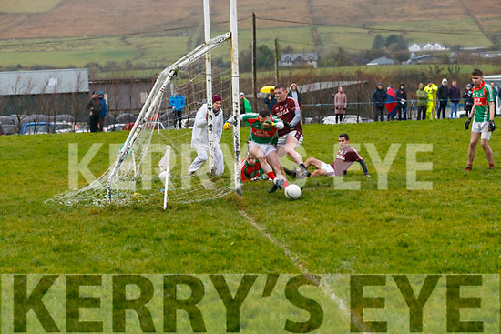 St Michaels/Foilmore's Mark Griffin sweeps the ball off the line denying Niall Ó Sé for Piarsaigh na Dromoda a goal scoring opportunity.