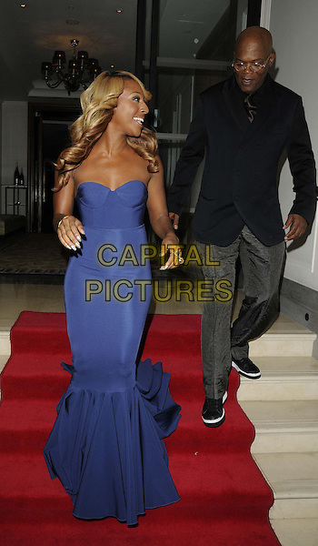 Alexandra Burke & Samuel L Jackson.attended the 'Shooting Stars Benefit' fundraising dinner & launch party, Corinthia Hotel, Whitehall Place, London, England, 20th October 2012..full length blue strapless fishtail dress long maxi smiling bustier grey gray trousers navy jacket blazer walking steps .CAP/CAN.©Can Nguyen/Capital Pictures.