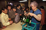 Russian men buying wine from Georgia in the wine shop Riga Latvia 1989  Former Soviet Union.