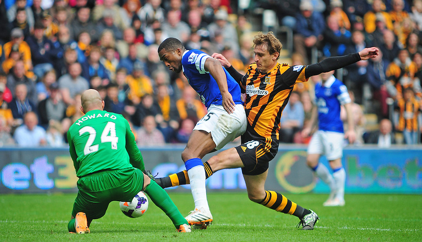 Everton's Tim Howard claims the ball as team-mate Sylvain Distin holds off the challenge from Hull City's Nikica Jelavic<br /> <br /> Photographer Chris Vaughan/CameraSport<br /> <br /> Football - Barclays Premiership - Hull City v Everton - Sunday 11th May 2014 - Kingston Communications Stadium - Hull<br /> <br /> &copy; CameraSport - 43 Linden Ave. Countesthorpe. Leicester. England. LE8 5PG - Tel: +44 (0) 116 277 4147 - admin@camerasport.com - www.camerasport.com