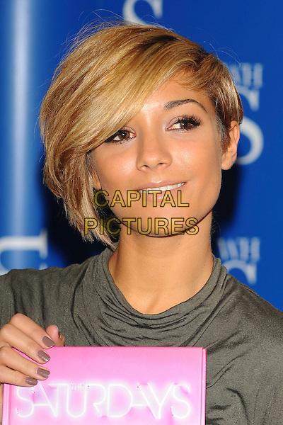 "FRANKIE SANDFORD of The Saturdays The Saturdays sign copies of their new book ""Our Story!"" at WH Smith, Bluewater Shopping Centre, Greenhithe, Kent, England, UK, 16th October 2010. portrait headshot smiling holding booksigning signing green grey gray nails nail varnish polish smiling .CAP/CJ.©Chris Joseph/Capital Pictures."