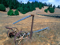 Old farm machine near Comptche,  in Mendocino County, CA..CD scan from 35mm chrome.  © John Birchard