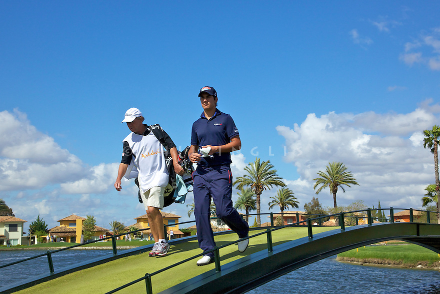Matteo Manassero (ITA) walks on the bridge at 15 during the first round of the Reale Seguros Open de Espana played at the Real Club de Golf de Sevilla, Seville, Andalucia, Spain 03-06 May 2012. (Picture Credit / Phil Inglis)