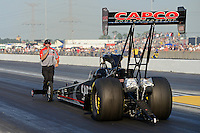 Jun. 29, 2012; Joliet, IL, USA: NHRA crew member for top fuel dragster driver Steve Torrence during qualifying for the Route 66 Nationals at Route 66 Raceway. Mandatory Credit: Mark J. Rebilas-