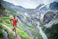 Trail running a loop from Fionnay, to Col des Ottans, to Cabane de Pannosiere and back to Fionnay, Val de Bagnes, Switzerland. Running along a perfect section of singletrack next to a bisse.
