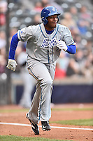 Hartford Yard Goats first baseman Correlle Prime (27) runs to first during a game against the Richmond Flying Squirrels at The Diamond on April 30, 2016 in Richmond, Virginia. The Yard Goats defeated the Flying Squirrels 5-1. (Tony Farlow/Four Seam Images)