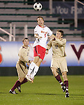 14 November 2008: Maryland's Jason Herrick (9) and Boston College's Stephen Hepburn (12). The University of Maryland defeated Boston College 1-0 at WakeMed Stadium at WakeMed Soccer Park in Cary, NC in a men's ACC tournament semifinal game.