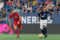 FOXBOROUGH, MA - AUGUST 31: Luis Caicedo #27 of New England Revolution brings the ball forward during a game between Toronto FC and New England Revolution at Gillette Stadium on August 31, 2019 in Foxborough, Massachusetts.
