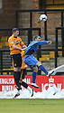 Dave Partridge of Cambridge United and Omer Riza of Histon contest a header during the Blue Square Bet Premier match between Cambridge United and Histon at the Abbey Stadium, Cambridge on 1st January, 2011.© Kevin Coleman 2011
