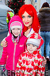 Isobelle and Olivia Freeman with Kimberley Harris, enjoying the CH Chemist Santa parade in Tralee on Saturday afternoon last.