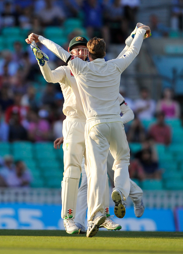 Australia's Steven Smith (back) congratulated after taking the wicket of England's Alastair Cook for 85<br /> <br /> Photographer Ashley Western/CameraSport<br /> <br /> International Cricket - Investec Ashes Test Series 2015 - Fifth Test - England v Australia - Day 3 - Saturday 22nd August 2015 - Kennington Oval - London<br /> <br /> &copy; CameraSport - 43 Linden Ave. Countesthorpe. Leicester. England. LE8 5PG - Tel: +44 (0) 116 277 4147 - admin@camerasport.com - www.camerasport.com