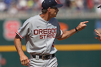 Oregon State head coach Pat Casey (5) argues with the umpire during Game 11 of the 2013 Men's College World Series against the Mississippi State Bulldogs on June 21, 2013 at TD Ameritrade Park in Omaha, Nebraska. The Bulldogs defeated the Beavers 4-1, to reach the CWS Final and eliminating Oregon State from the tournament. (Andrew Woolley/Four Seam Images)