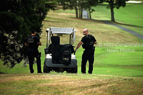 United States Secret Service members use a golf cart while providing protection for U.S. President Barack Obama while he golfs at the Army installation's course July 15, 2012 in Fort Belvoir, Virginia. Obama also campaigned in Virginia, a state he won in 2008, on Saturday, holding events in Fairfax and Glen Allen. .Credit: Chip Somodevilla / Pool via CNP