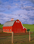 Whitman County, WA      <br /> ed barn with gambrel rood under morning clouds with rolling hills of the Palouse in the background near Oakesdale, WA