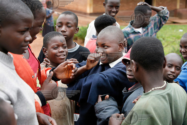 Deaf children chat at the Centre d'Education Specialise pour Deficients Auditifs Notre Dame de la Perseverence in Gitega. This is a special school for deaf children and children with hearing problems. There is an enormous waiting list for the school which can only accept 150 students per year.