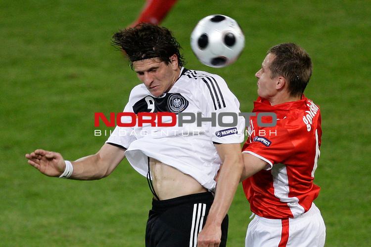 UEFA Euro 2008 Group B Klagenfurt - W&ouml;rthersee Match 04 <br /> <br /> Deutschland ( GER ) - Polen ( POL )<br /> <br /> Kopfballduell zwischen  Mario Gomez ( Germany / Angreifer / Forward / VFB Stuttgart #9) Jacek Krzynowek  ( Poland / Mittelfeldspieler / Midfielder / VfL Wolfsburg #08 )<br /> <br /> <br /> Foto &copy; nph (  nordphoto  )<br /> <br /> <br /> <br />  *** Local Caption ***