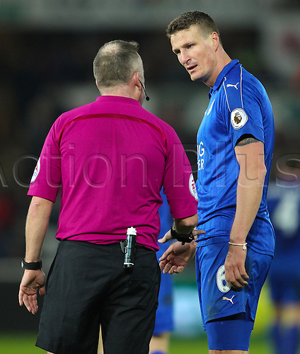 February 12th 2017, Liberty Stadium, Swansea, Wales; Premier league football, Swansea versus Leicester City; Referee Jonathan Moss speaks with Leicester City's Robert Huth after a clash with Swansea players