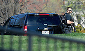 A secret service agent patrols the North Lawn of the White House after reports of shooting on Capitol Hill March 28, 2016 in Washington, DC.<br /> Credit: Olivier Douliery / Pool via CNP