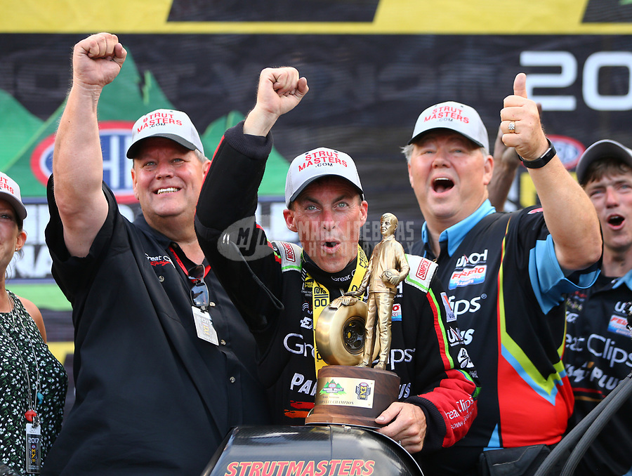 Jun 18, 2017; Bristol, TN, USA; NHRA top fuel driver Clay Millican celebrates with crew after winning the Thunder Valley Nationals at Bristol Dragway. Mandatory Credit: Mark J. Rebilas-USA TODAY Sports