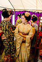 Geishas (Maiko and Geiko) preparing for Nishijin Yume-matsuri (festival), Kitano-Tenmangu Shrine, Kyoto, Japan