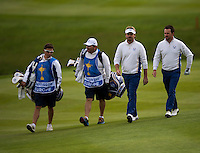 27.09.2014. Gleneagles, Auchterarder, Perthshire, Scotland.  The Ryder Cup.  Graeme McDowell and Victor Dubuisson (EUR) and caddies walk to the 9th green.  Saturday Foursomes.