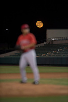 A harvest moon rises behind AZL Angels relief pitcher Kiber Arvelaez (31) as he prepares to deliver a pitch during an Arizona League game against the AZL Indians 2 at Tempe Diablo Stadium on June 30, 2018 in Tempe, Arizona. The AZL Indians 2 defeated the AZL Angels by a score of 13-8. (Zachary Lucy/Four Seam Images)